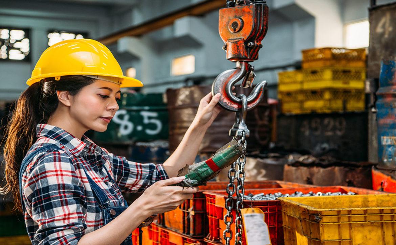 worker wearing helmet holding remote control